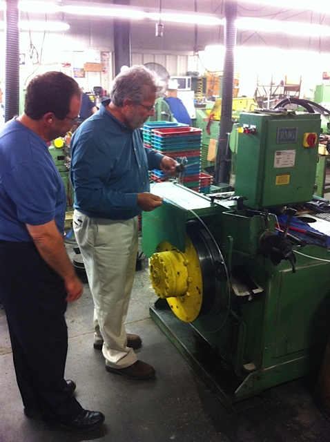 George inspecting the customer bolt manufacturing process in Southeast         Massachusetts