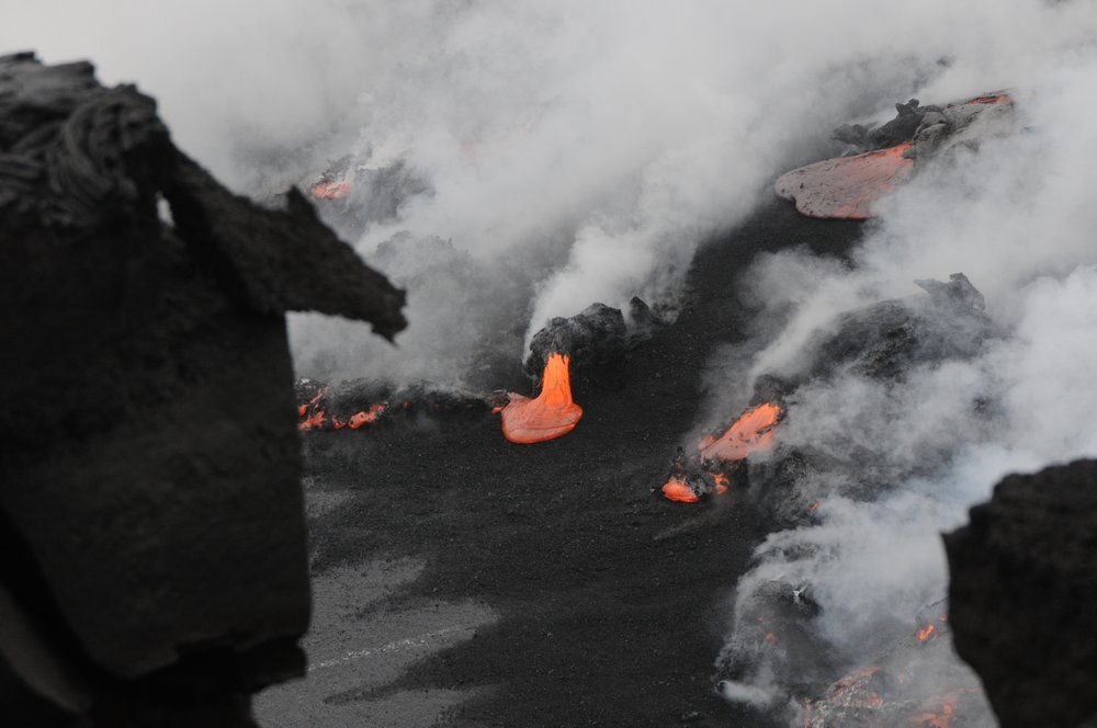 Black sand forming as lava hits the ocean from Kilaueu volcano.                                                                              PHOTO:PHILIP MAISE, CC BY-SA 3.0 Unported