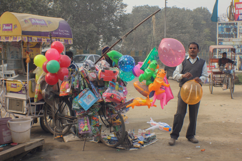 Toy vendor, Noida, Uttar Pradesh