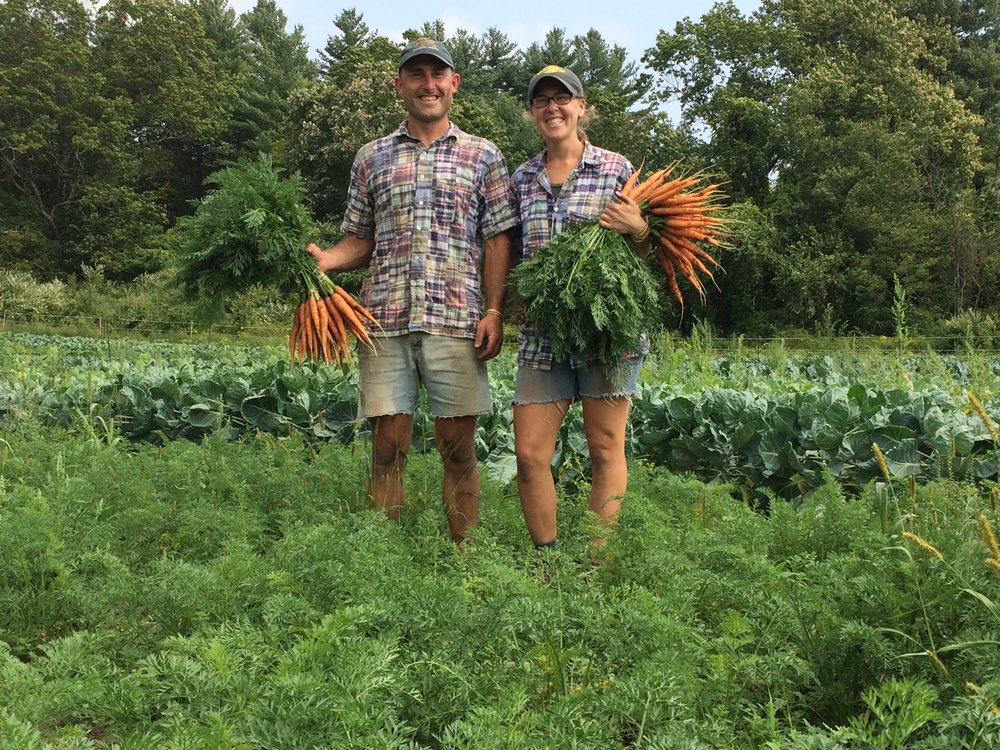 Shaun's birthday carrot harvest. Doesn't everyone celebrate by wearing matching outfits with their co-workers?