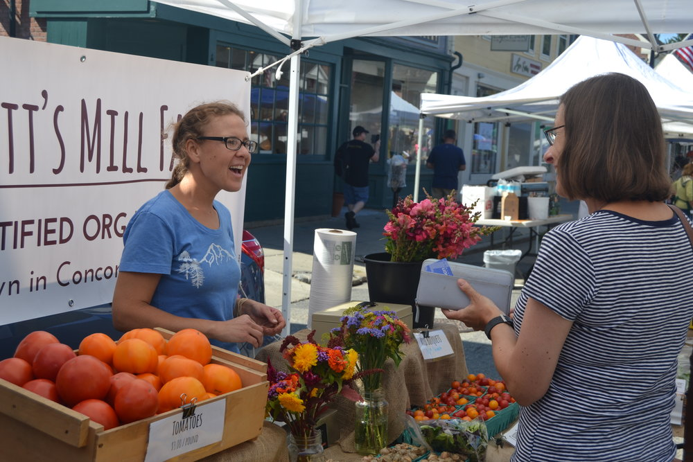 Melissa chats with a customer at last year's Ag Day farmers market.
