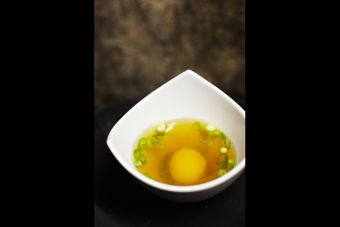 Ham broth, slow cooked egg yolk, spring onions, peas, potato chips