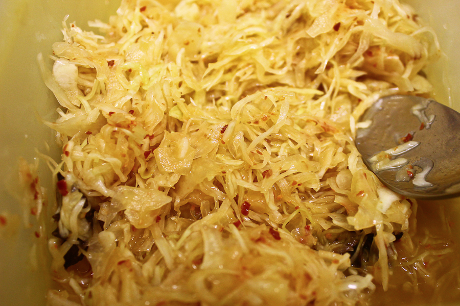 "First sauerkraut/kimchi experiment. Shredded cabbage pickling in salt with aleppo pepper flakes, star anise and roast hay-infused honey. Coming up to three weeks old. Inspired by the arrival of ""Wild Fermentation"" by Sandor Katz ( @sandorkraut )"