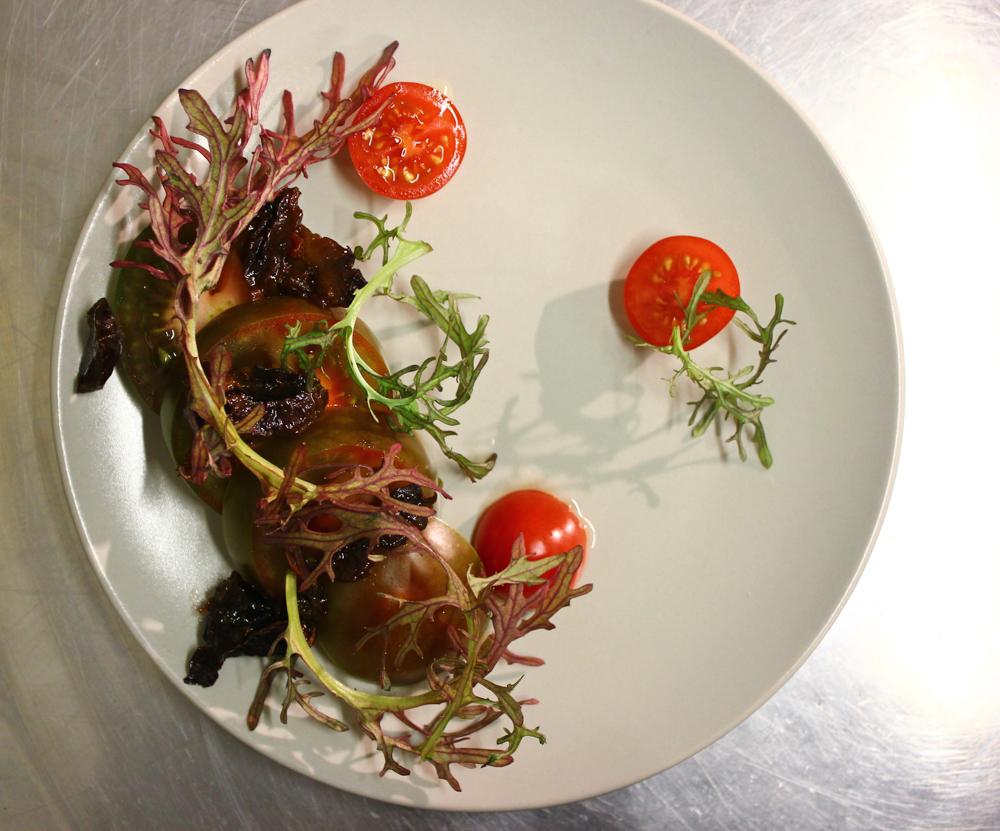 Tomatoes, prunes, nasturtiums, dill seed vinegar, lettuce