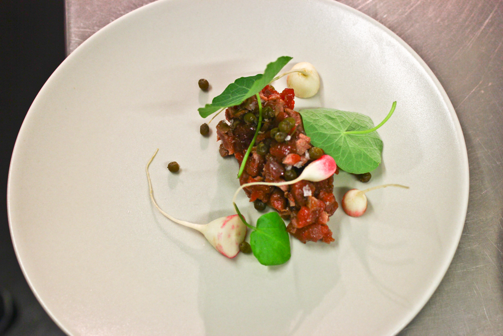 Muntjac tartare, radishes, nasturtiums, preserved elderberries