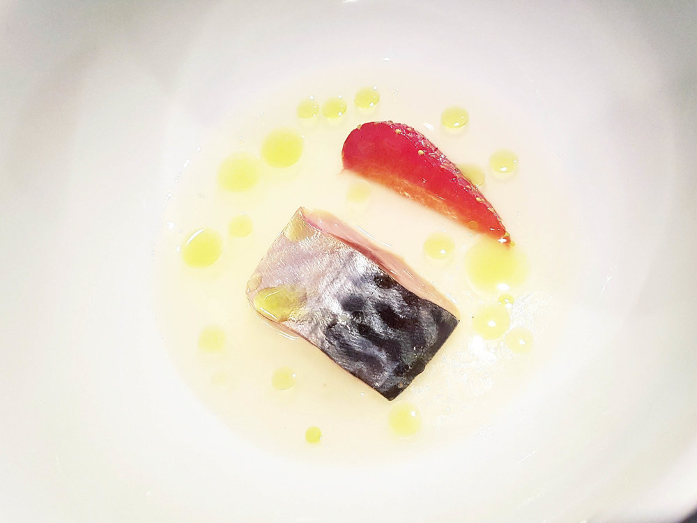 Mackerel cured in mackerel garum, yellow tomato water, tomato stalk oil, strawberry The Future Laboratory, July