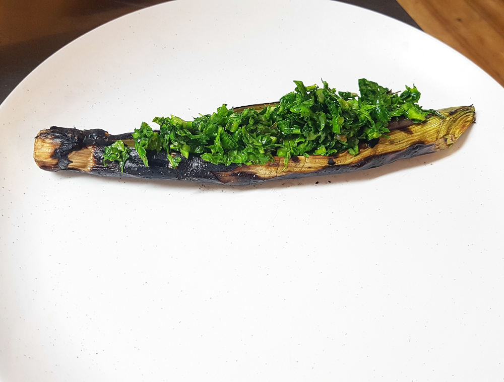 Barbecued leek, fermented and roasted mushroom paste, and salad of black mustard, pickled ramson buds and tarragon