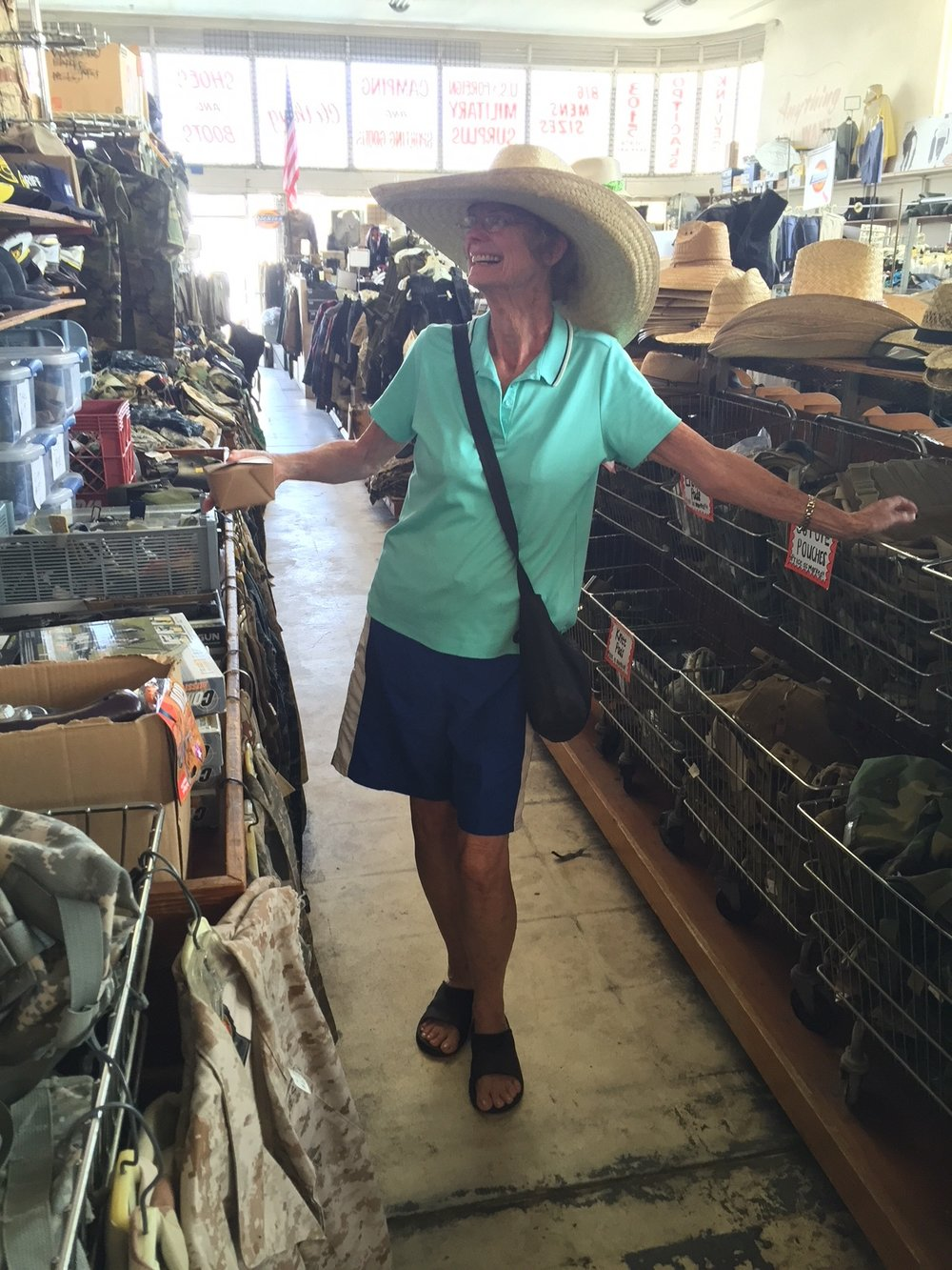modeling a hat in a california army surplus store