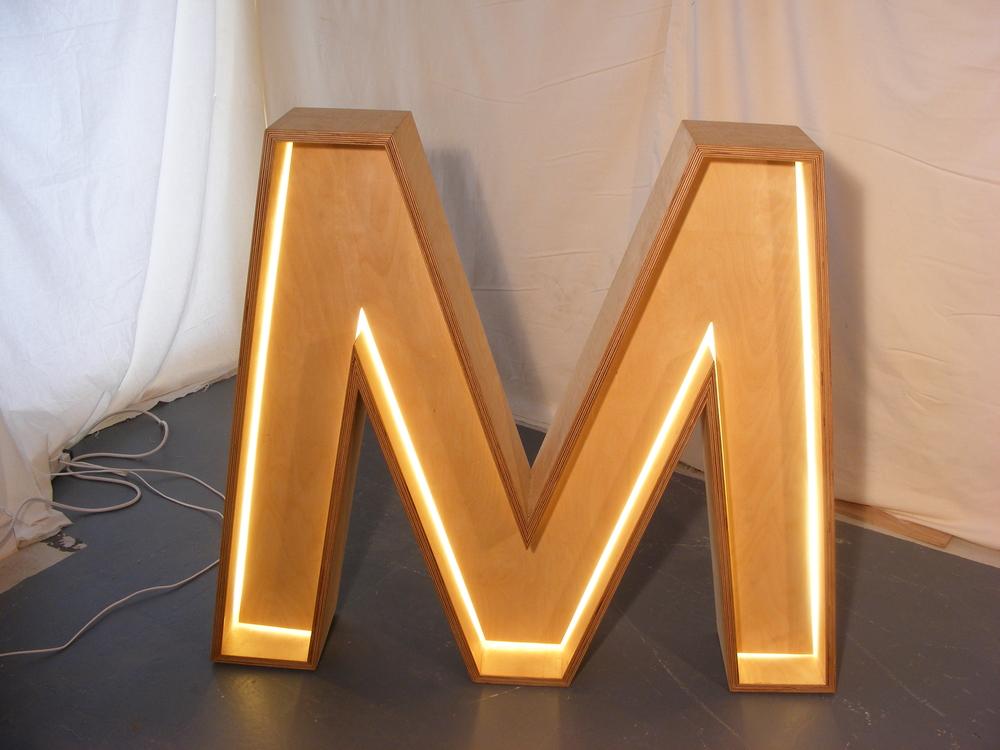 Light up letter M