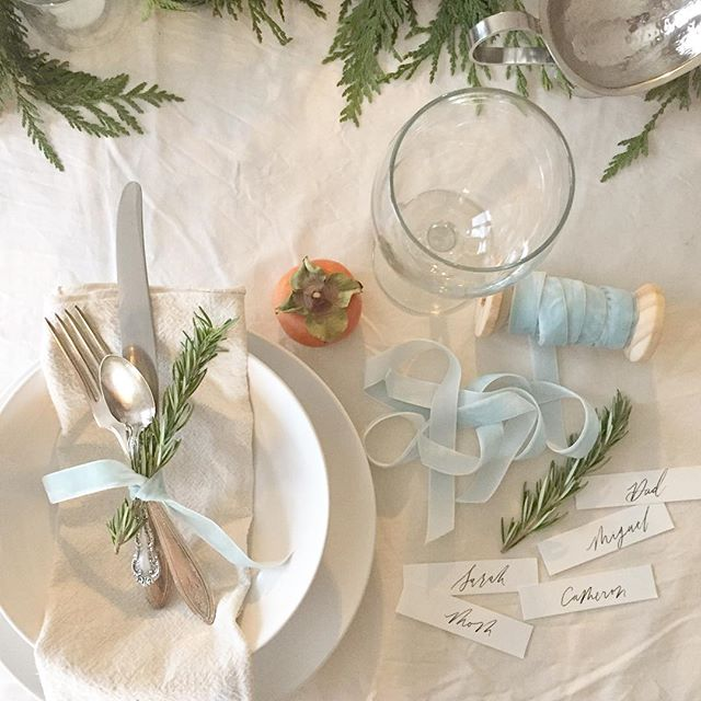 """We went for pearly white holiday decor this year with a touch of greenery. — What are some of your holiday decorating """"go-to's""""? Also-I can't believe this is the only picture I took on my phone of the table setting 😱 #thatsafirst #oops #iliketocollectthem"""