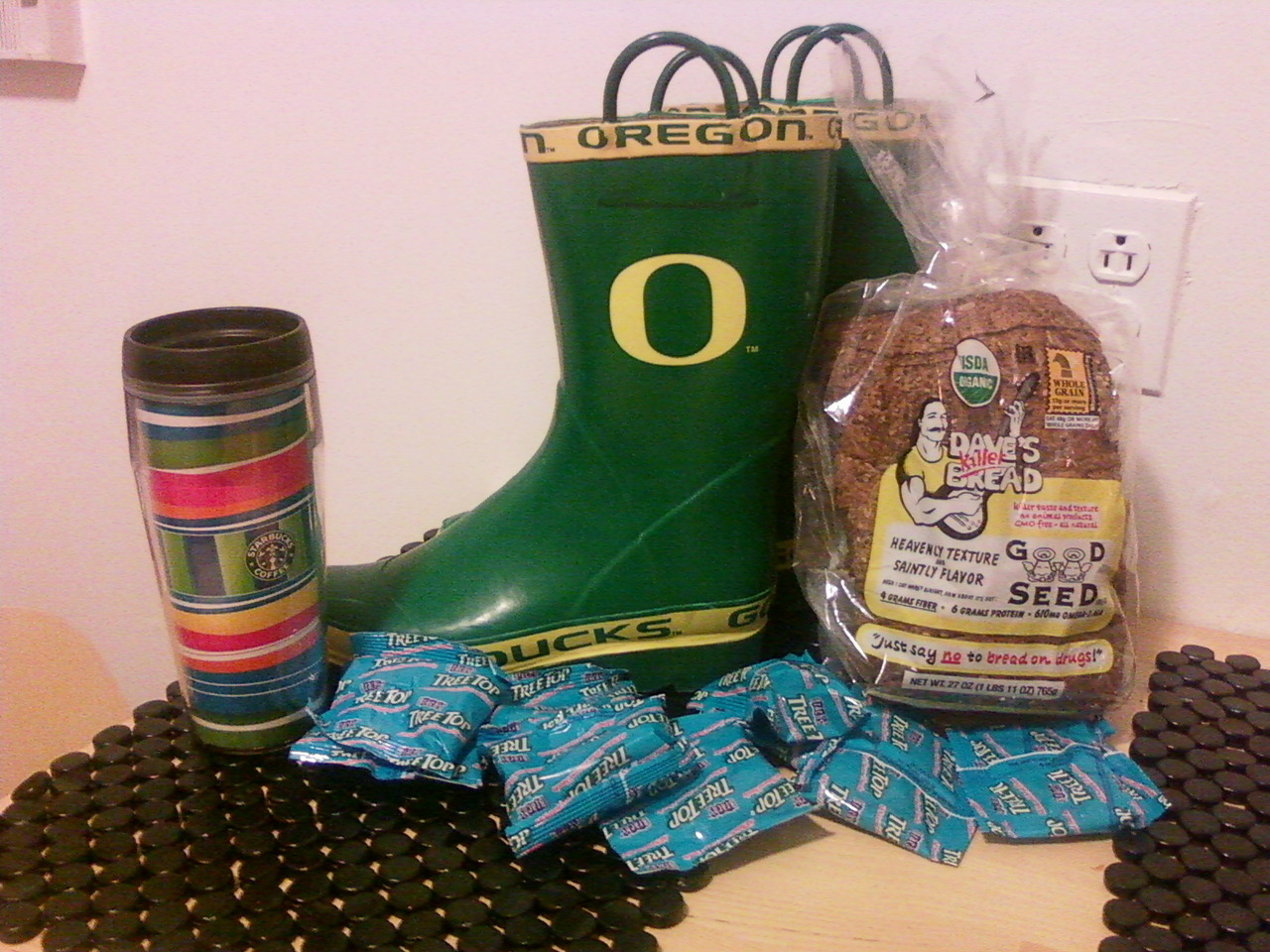 "What's better than Christmas presents? Getting boxes of your own things mailed to you from coast to coast! Today's arrivals? RAIN BOOTS!!! My Oregon duck rain boots to be exact. You can bet I'm going to be repping my ducks to and from the subway every rainy day from here on out!    It gets even better though.. Guess what other surprises were in the box? DAVE'S KILLER BREAD!!! Aww, I'd say today was a good day and that my Mom is pretty darn awesome! There was also some random things of mine, earrings, pens, a coffee tumbler, and lots of fruit snacks. Scooter was pretty excited about the fruit snacks too I think, because I caught him trying to run off with more than one package. Which brings me to another discovery today. My dog is a total hoarder, but that can be its own blog post in itself.   Another reason today was a great day was because it was my one month anniversary of being in New York! I am officially surviving the New York life and doing it well! After a month I think it is a good time to reflect on some of the biggest misconceptions I've come before and during my move here and let you know how they are rolling out.   1.) ""Why would you want to move to New York, it's soooo expensive!"": I will not deny that New York is definitely not the cheapest place to live. I won't try and tell you that the statistics are wrong, but what I will tell you is if you have a steady job and realistic expectations it can be totally doable. Apartment standards in New York are different than anywhere I've ever lived. You will probably pay double the amount for half of the space you would be used to in a typical Portland or Seattle apartment without the added luxuries. Most of the buildings that are more affordable are in Pre or Post WWII buildings that are not always equipped with elevators, microwaves, or dishwashers but realize that your friends are all probably living in about the same situations too. It's been a month though and we have been completely fine without a microwave, dishwasher, and cable tv at that. What I'm trying to say is yes, rent is very high in New York, but it is still possible to find a cute, small apartment in a safe neighborhood and still manage to have some money left over for food and exploring.   If it is something you want to attempt though, my advice is to have realistic expectations. Prioritize what is important to you in a living situation and set a realistic price range. Rent is the highest price difference when moving. Food can be expensive as well, but if you minimize the amount of take-out food you order and score deals by trying different grocery stores (like Trader Joes) then it won't be such a huge difference. The great thing about New York too is that there are a ton of events going on all of the time (a lot of which are free). My final point being, yes the city is expensive, but if you set a budget and are smart with your money then you should have no issues.   2.) ""But New Yorkers are so mean!"": Another misconception I faced when moving was that all New Yorkers were rude and mean people. Over the course of the last month, I can truthfully say that I think the opposite is true. Granted, this is my personal experience and I am by no means saying that the ""mean New Yorker"" stereotype doesn't hold true sometimes. From my experience though, I have yet to have an awful experience with anyone. People in the city are busy and might not always talk to you in passing, but if you give a smile I have always gotten one back in return. I can honestly say that I've felt more welcomed by New Yorkers here than I often did in Portland. If I stop to pick up an outfit on my way home someone is chatting up with me in the dressing room and asking for my style advice. If I'm grocery shopping alone the employees are sure to strike up a conversation with me. Even when I meet people at a party or out people genuinely seem interested in meeting me and are excited about hearing my story. I don't know if I'm the only one who has had this experience, but I really think that New Yorkers get an undeserving bad rep sometimes. Again, I've only been here a month, but I can tell you I've been shocked of how friendly the people have been to me during my stay.   3.) ""You're not taking your car?! How will you survive!"": I've had a car since I was 16 years old and a month ago I can admit I was a little apprehensive about not having a car either. Truth be told though, New York's public transportation is great! Besides my occasional mix-up on a subway stop I feel like I have a good handle on getting myself where I need to go. Of course I still need some help from websites like HopStop to ensure I'm getting on the right train or bus, but overall the system is pretty easy to figure out.    After not having my car for a month too, I can't say I miss it too much (and I definitely don't miss paying for insurance or gas). I've been on enough cab rides, and bus rides to realize I probably wouldn't be the best New York driver anyways. Besides, rides by cabs can actually end of taking longer than a subway ride because of traffic. So although I probably wouldn't be okay with not having a car in the Northwest in New York it has been perfectly alright. I have yet to meet anyone here that does actually drive either so I don't feel like I'm missing out on too much.   Well there you have it! One month down, three misconceptions addressed and many more experiences and lessons to come. Stay tuned for more.   Cheers!"