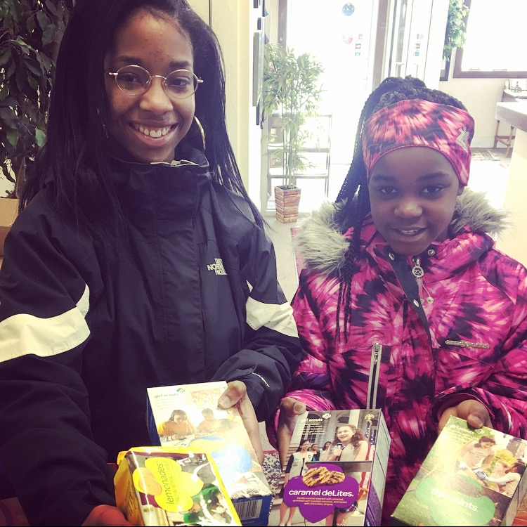 Girl Scout Ambassador, Sherese Thomas (left)  and Jr. Girl Scout, Imani Thomas (right) stopped by our office to make a few sales and share some smiles. We love Girl Scout Cookies! Thanks Girls! Keep Up The Good Work! Troop Leader Shelia is their troop leader.