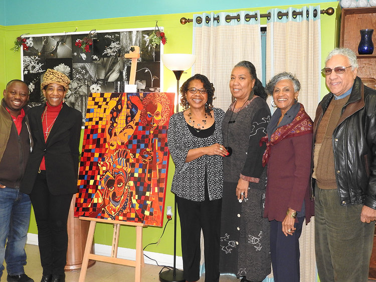 ART FOR ARTISTS: Pictured (L-R) at the recent Holiday Art for Artists auction, Rubens Mukunzi,Jessica Thorpe, Glendora Johnson-Cooper. Dawn Martin-Berry-Walker, Betty Pitts-Foster and Jim Pappas.