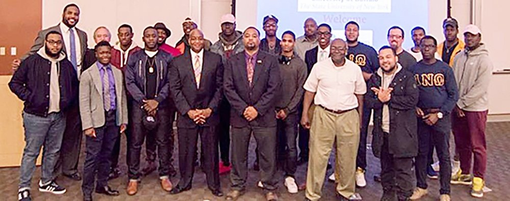 Guest Speaker Judge Hannah (center left) and UB Campus Minister Marchon Hamilton II (far right rear) with some of the event attendees of Guy Talk.   photos contributed by Benjamin Blanchet