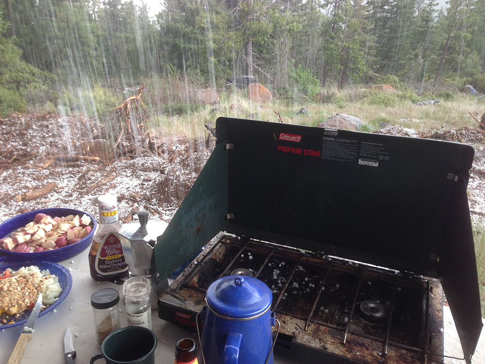 Base camp cooking in a hail storm
