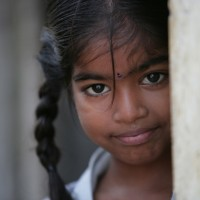 Renu, match factory worker, 5 years old, Tamil Nadu, India. By: Marcus Lyon.