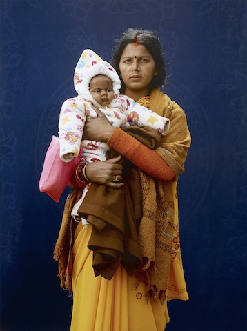 Kumbh Mela Pilgrim - Mamta Dubey and infant by Giles Price, 2013