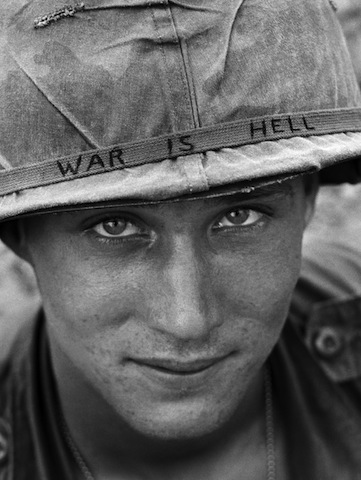 An unidentified American soldier wears a hand-lettered slogan on his helmet, June 1965. The soldier was serving with the 173rd Airborne Brigade on defense duty at the Phuoc Vinh airfield. (AP Photo/Horst Faas)