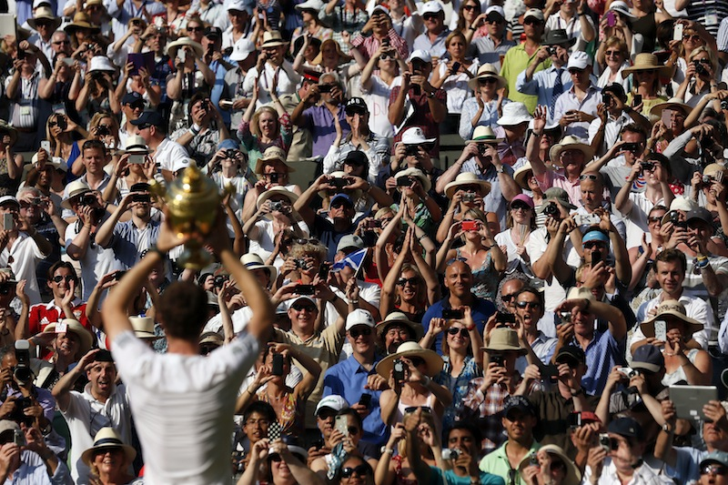 Andy Murray of Great Britain holds the winner's trophy up to the  spectators after defeating Novak Djokovic of Serbia in the men's  singles final at the Wimbledon Championships.  © Stefan Wermuth / Reuters
