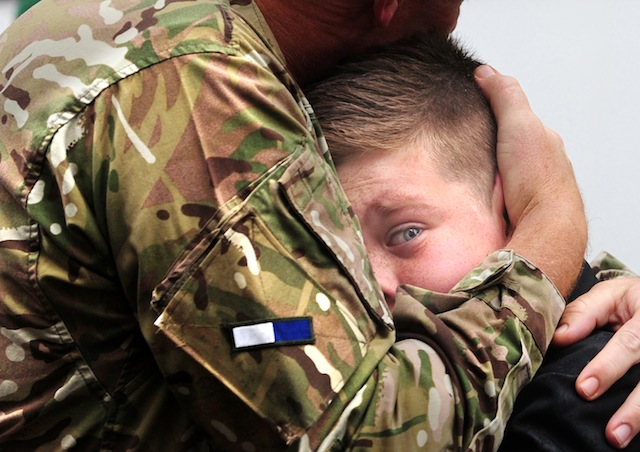 CO Vaudin of 2 Signal Regiment embraces his son, Nicholas, 12,  on his return from Afghanistan. Anthony Chappel-Ross © The Press, York