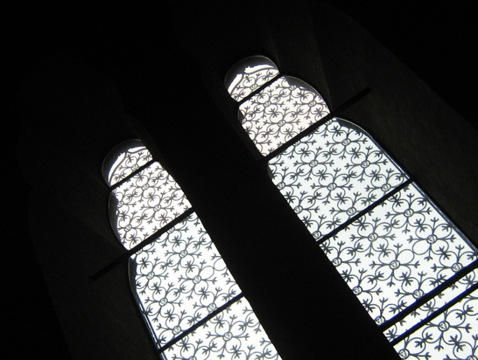 There are two sets of negative space working to create an image here. The black outlines the windows; the light coming through the window highlights the detailing of the latticework.