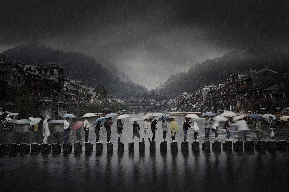 Winner of the Open Category: Chen Li for his 'Rain in an Ancient Town' (Chen Li (China) Winner Open Travel 2014 Sony World Photography Awards)