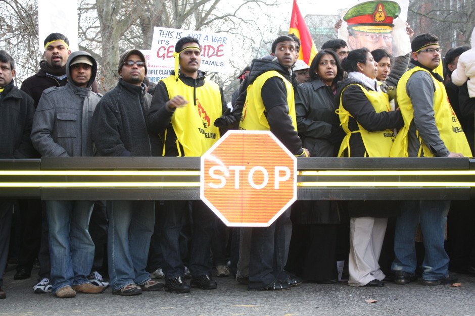 Tamil protestors, London, February 2009. The crush behind the barrier, the emptiness before the barrier, and the 'Stop' sign.