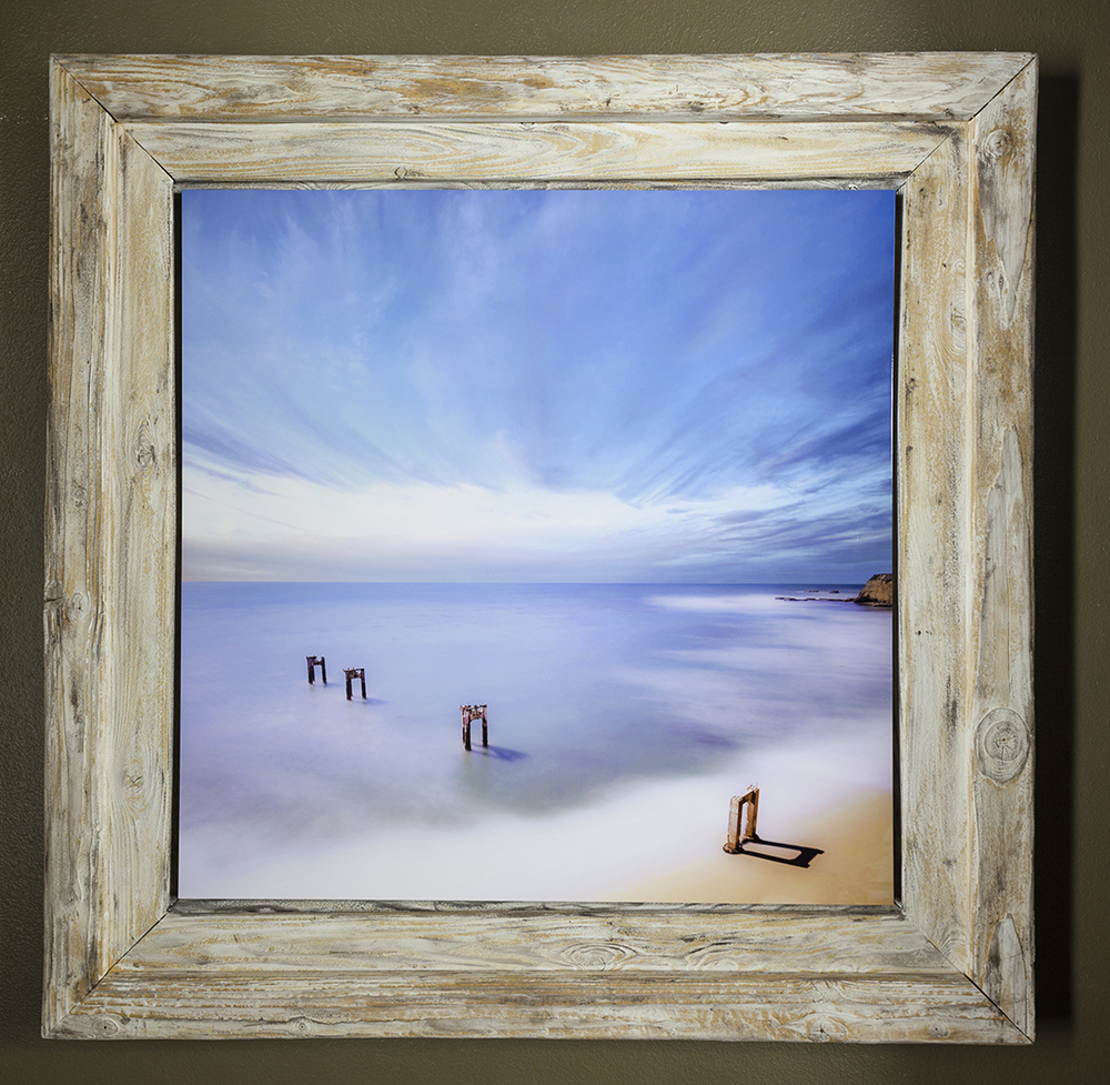 """Coming Ashore"" in a large 5 foot thematic frame made from sand blasted 4x4's in order to emulate the ocean eroded structures in the image (image is meant to compliment ""420 Light"" as a pair)"
