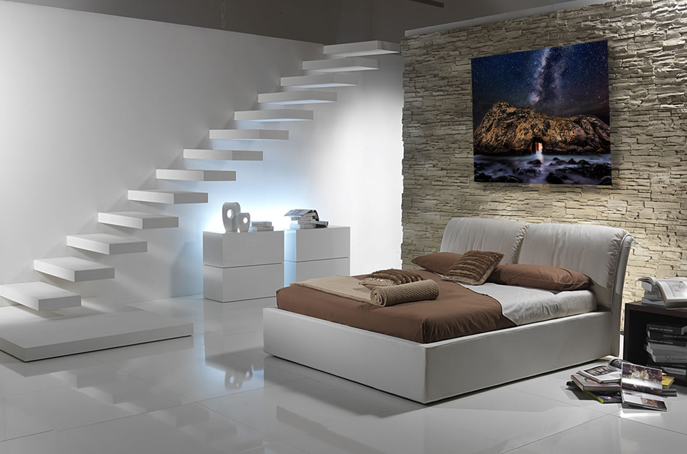 """Dimensional Passage"" is just plain ethereal as a large metal print with a floating hanger on a customized rock wall in a modern downstairs bedroom."
