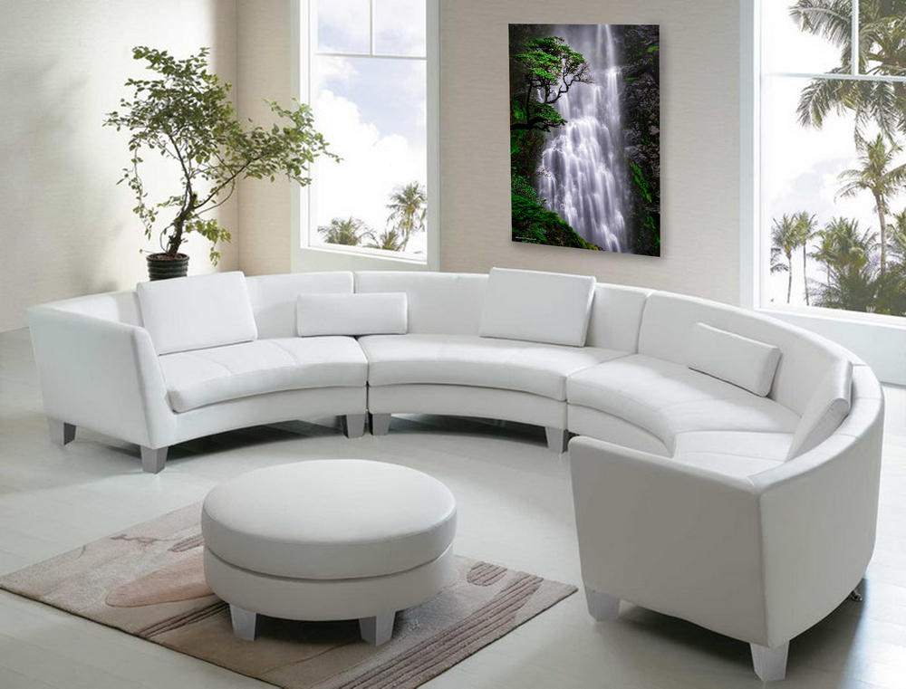 """Impressions in the Mist"" emanates transcendence on the wall of this bright California sun-room with a circular couch."