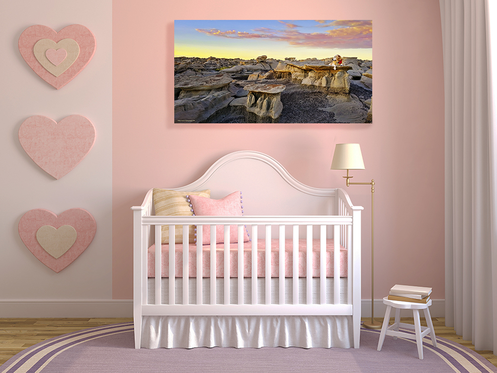 """Beholding the Daybreak"" creates a nice companion on the wall above to gracefully watch over this baby's crib."