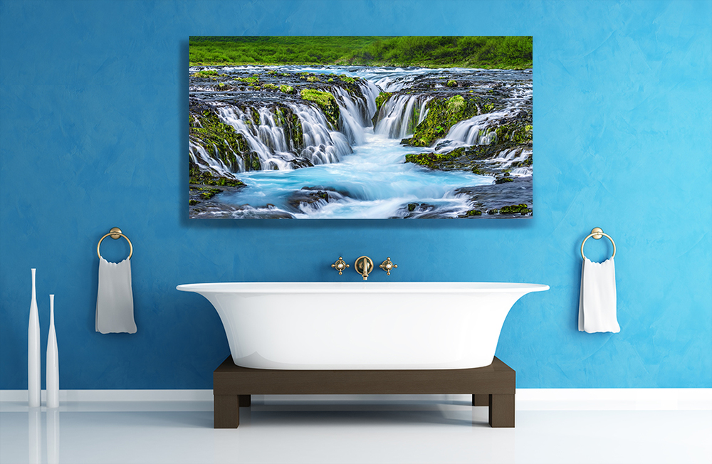 """Salience of Blue"" is impeccable as a metal print with a floating hanger in this richly colored blue bathroom...this literally gives the impression that the blue Icelandic glacier water in the picture is flowing into the tap and out into the bathtub!"