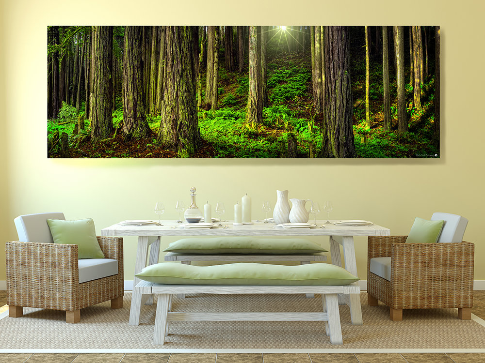 """Dawn in the Redwoods"" exudes an outdoor vibe as it totally lights up the wall above the table in this dining room giving the impression of dining under great redwoods in the California northwest."