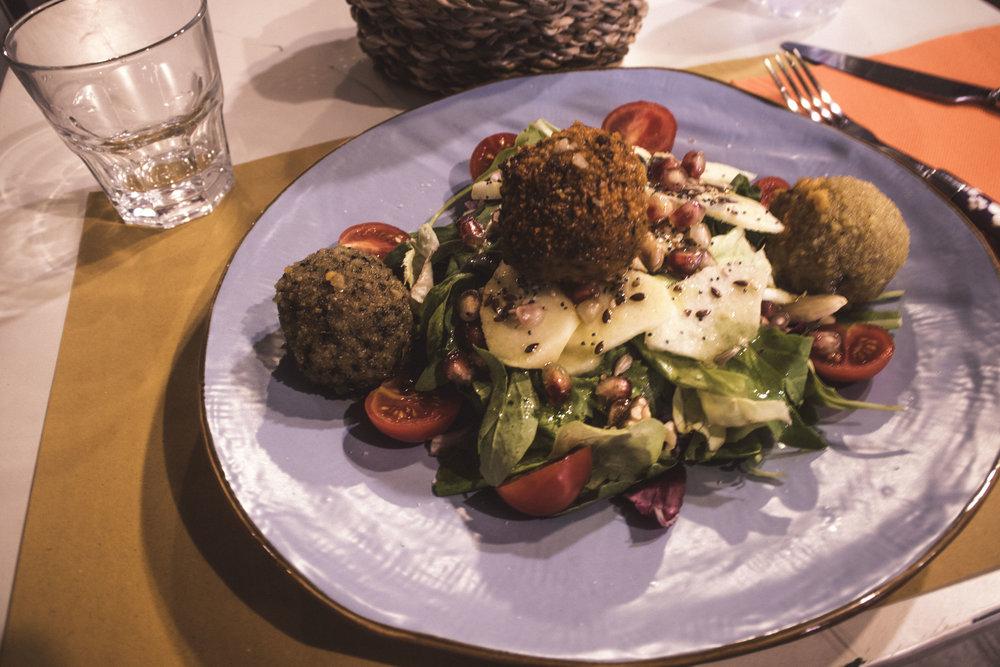 The best meatballs atop a delicious salad at Obla Di Obla Da restaurant in Rome, Italy