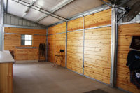 Lumber Packages  We give our barns the warmth of wood with a #1 Hand Select Southern Yellow Pine that we have milled specially for us.   *When you want an overhead roll-up door, we can give you the framed opening and you can pick the door you want locally. You can have it installed by the company you purchased from. This will ensure they warranty their work.