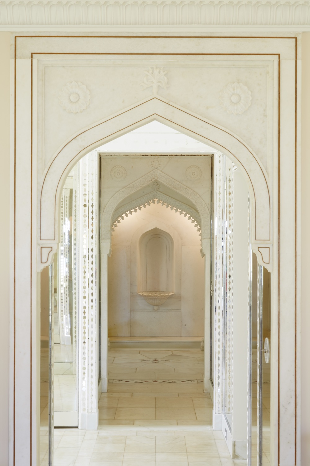 Bathroom of the Mughal Suite featuring marble wall panels and floor with inlaid stone. © 2014, Linny Morris, courtesy of the Doris Duke Foundation for Islamic Art, Honolulu, Hawai'i.