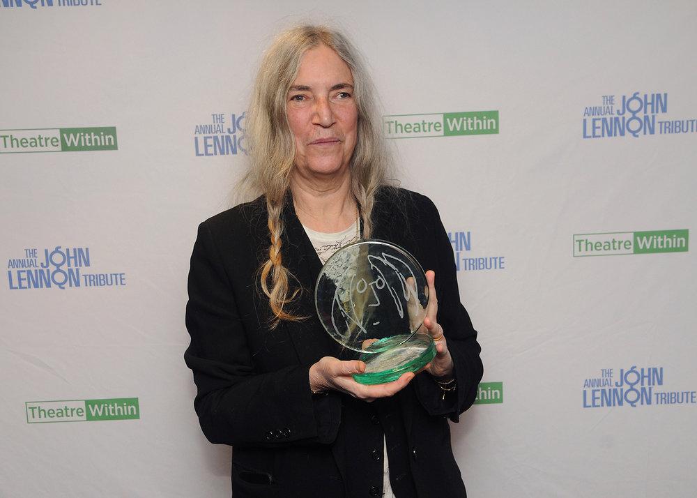 Patti WIth Award.jpg