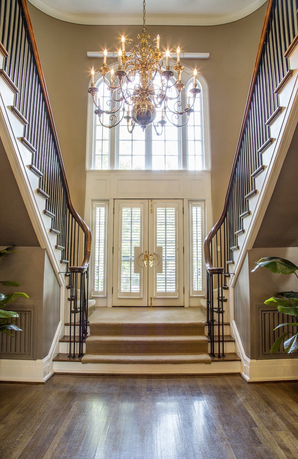 A Goldsboro artisan  hand-carved the curved wooden banister rail on the double staircase, a feature proposed by wife of the original owner  Mrs. Dail.