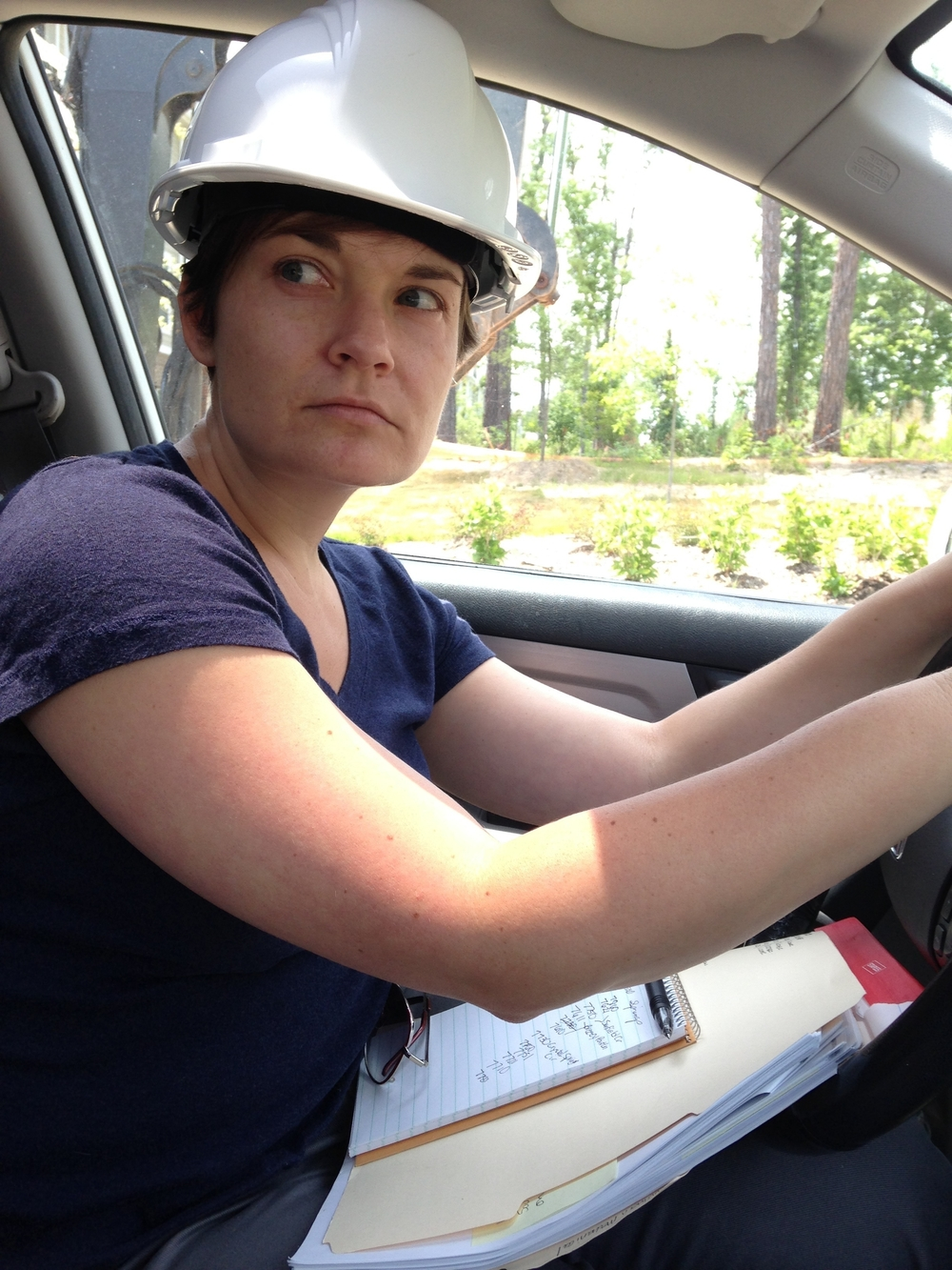 Mandy  visiting a construction site while reporting on worker misclassification in summer 2014.