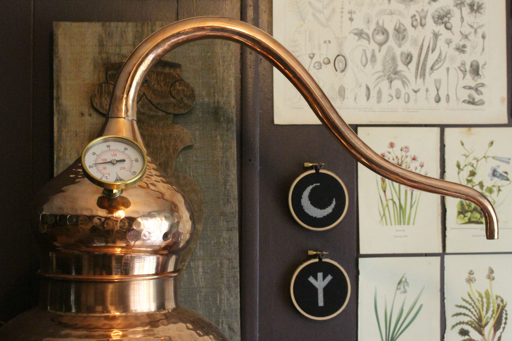 A copper distiller in Ash Sierra's home