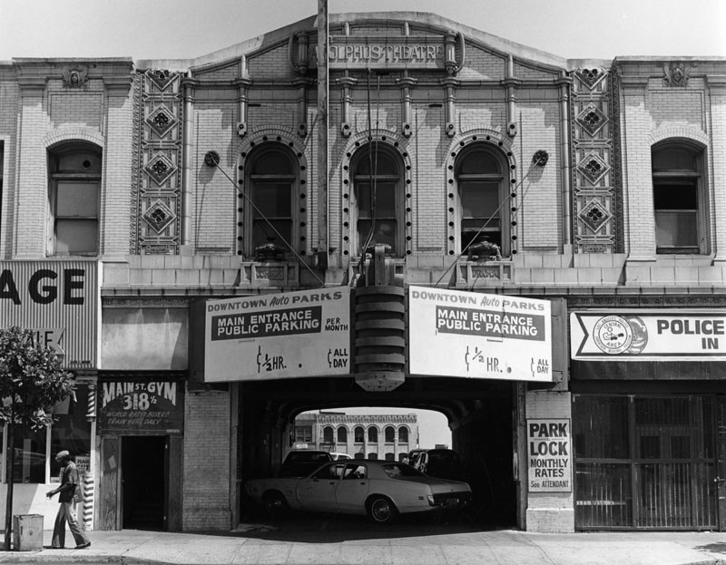 """""""Parking garage, Adolphus Theater"""" by William Reagh, a photographer who lensed Los Angeles and its surroundings from the late 30's until about 1991. I don't know L.A. very well, but stuff like this is nevertheless just fascinating. The Los Angeles Public Library has a  collection of his images  that you should go get sucked into now. It's good, solid, documentary stuff, with a fine sense of composition and light."""