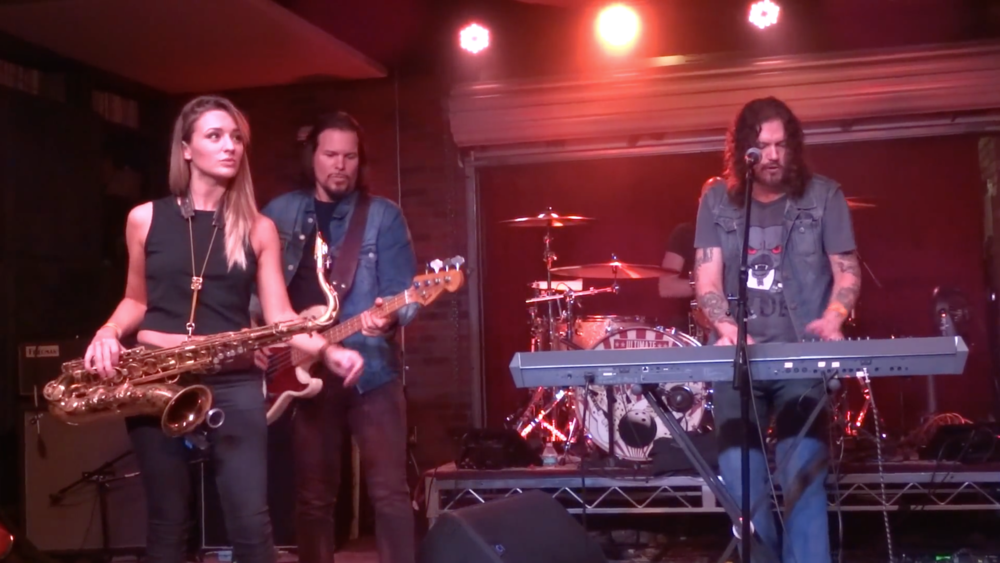 Guns n Roses Dizzy Reed with sax player Mandy Faddis at Lucky Strike Live