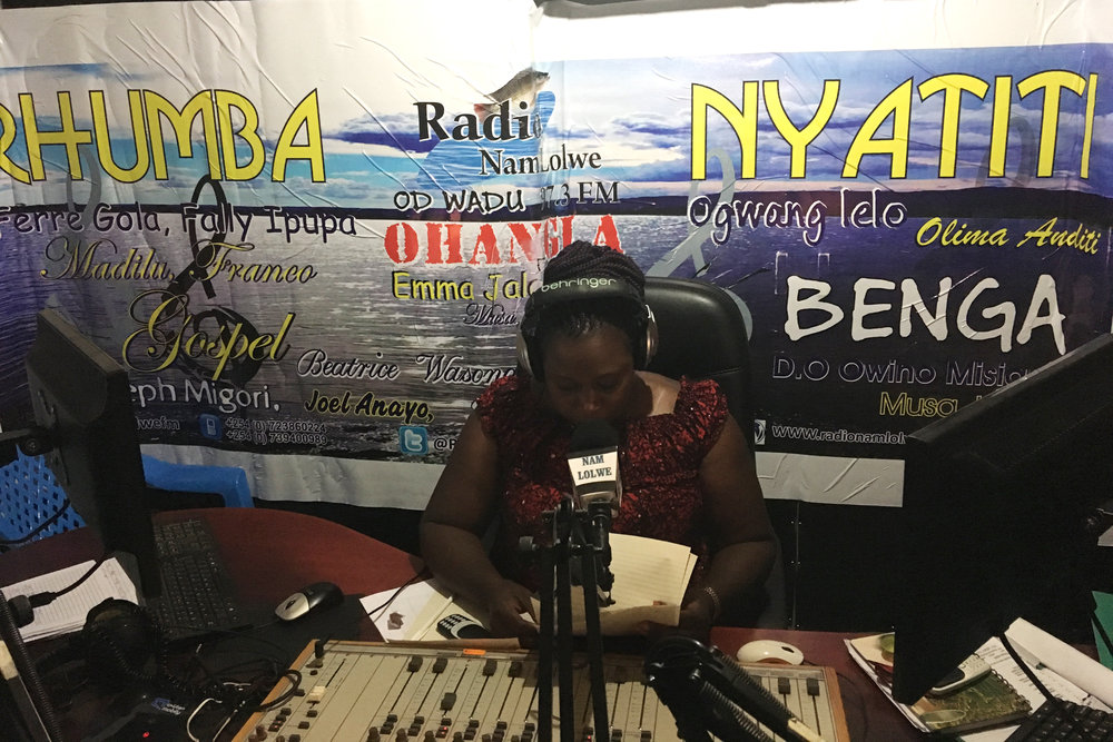 At Nam Lolwe radio, note Olima Anditi's name on the right side of the poster.