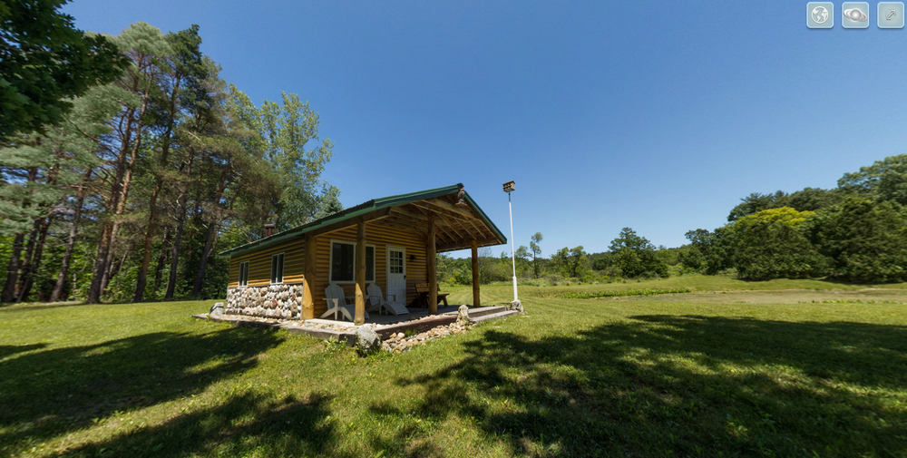 View an interactive 360 degree spherical panorama of a beautiful river front rustic cabin in Greenville, Michigan.