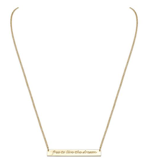A subtle bar necklace goes so well with sweaters and layers, this one from Liberti has a special message and cause.
