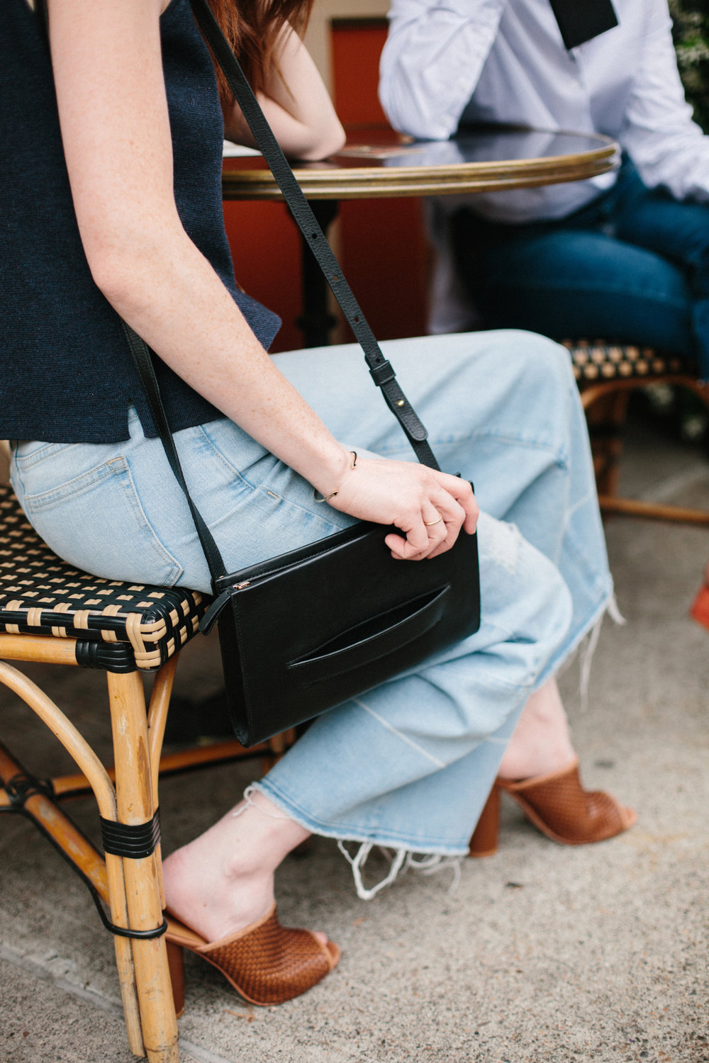 ethical black leather clutch