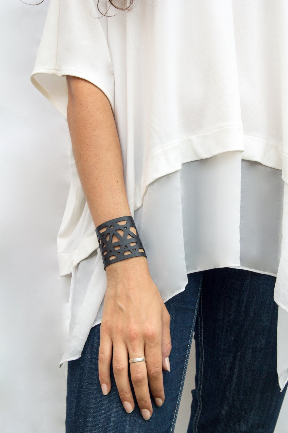 VARUNA CUFF | $45 - The Varuna Cuff is upcycled from the inner tubes of tires and lovingly handcrafted in Bali. The comfortable waterproof material makes it perfect for everyday wear while the geometric pattern makes it a statement piece that can dress up any outfit!