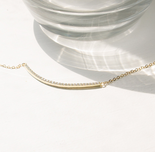 ARC NECKLACE | $74 - A modern classic - The Pavé Arc Necklace is thoughtful designed with 29 lab-created gems, each handset into a delicate arc to perfectly highlight your collarbone with a subtle sparkle. Responsibly handcrafted in China, this brand is redefining what