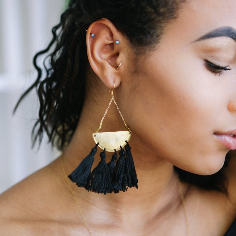 BRASS TASSEL EARRINGS | $69 - These Brass Tassel Earrings combine the bold look of brass with soft playful black tassels. Turn any outfit into an instant head-turner when you add these beauties to your look!
