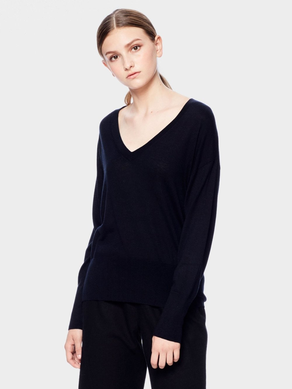 CASHMERE SWEATER | $105 - A luxury blend of Cashmere and Silk defines SiiZU's Inanna sweater as a must-have wardrobe basic.  It features Deep V neckline, drop shoulder line, and high-low hem. Sustainably made and ethically manufactured, this sweater is sure to please!